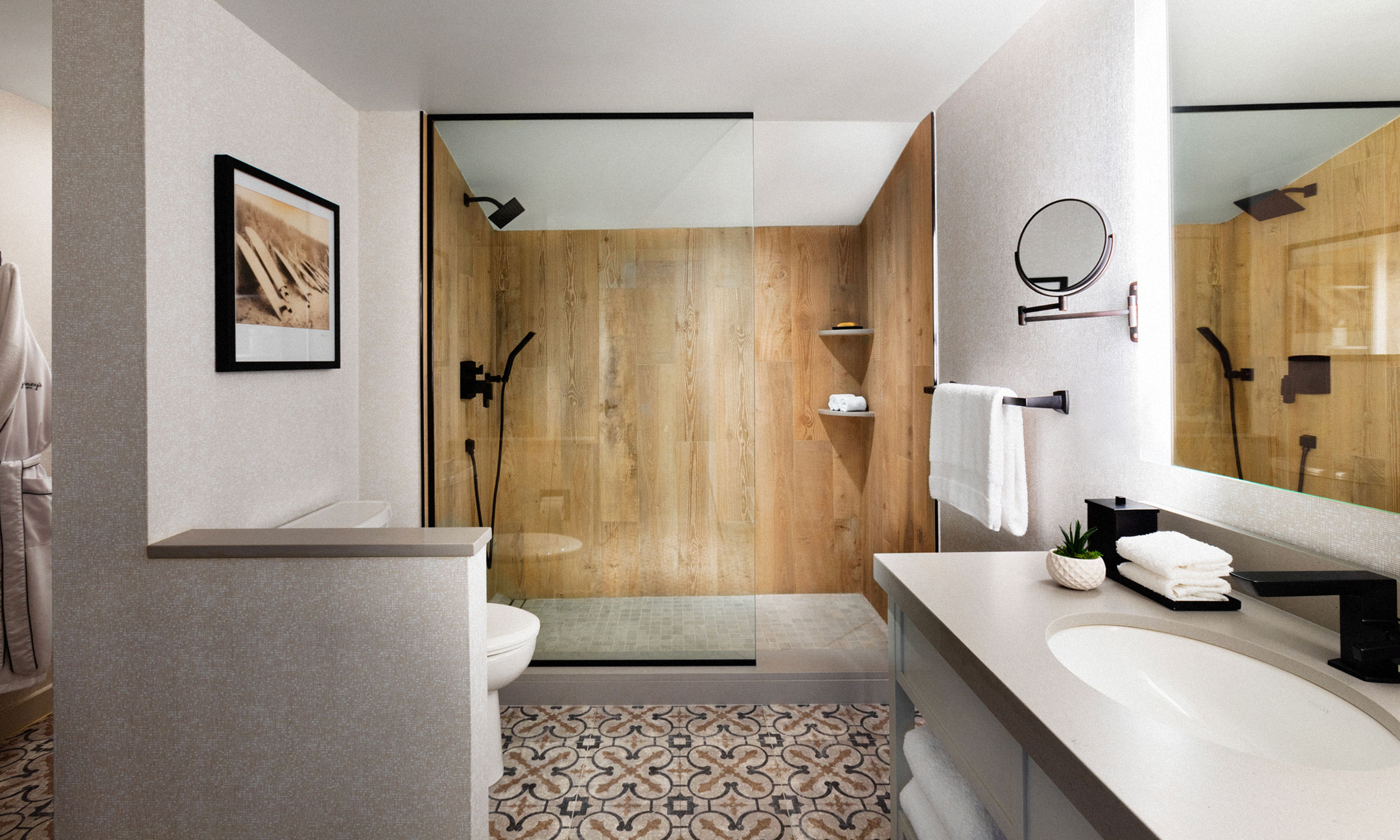 bathroom with wood wall shower, sink and mirror