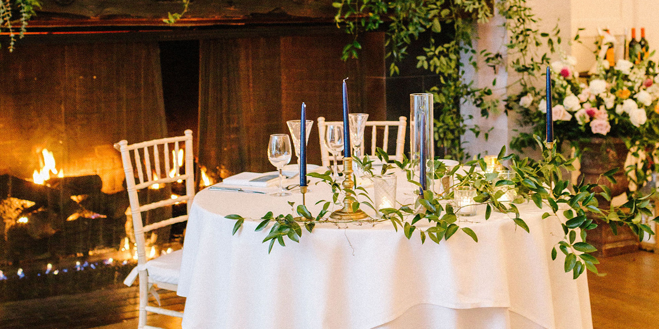 Table set for wedding in front of fireplace