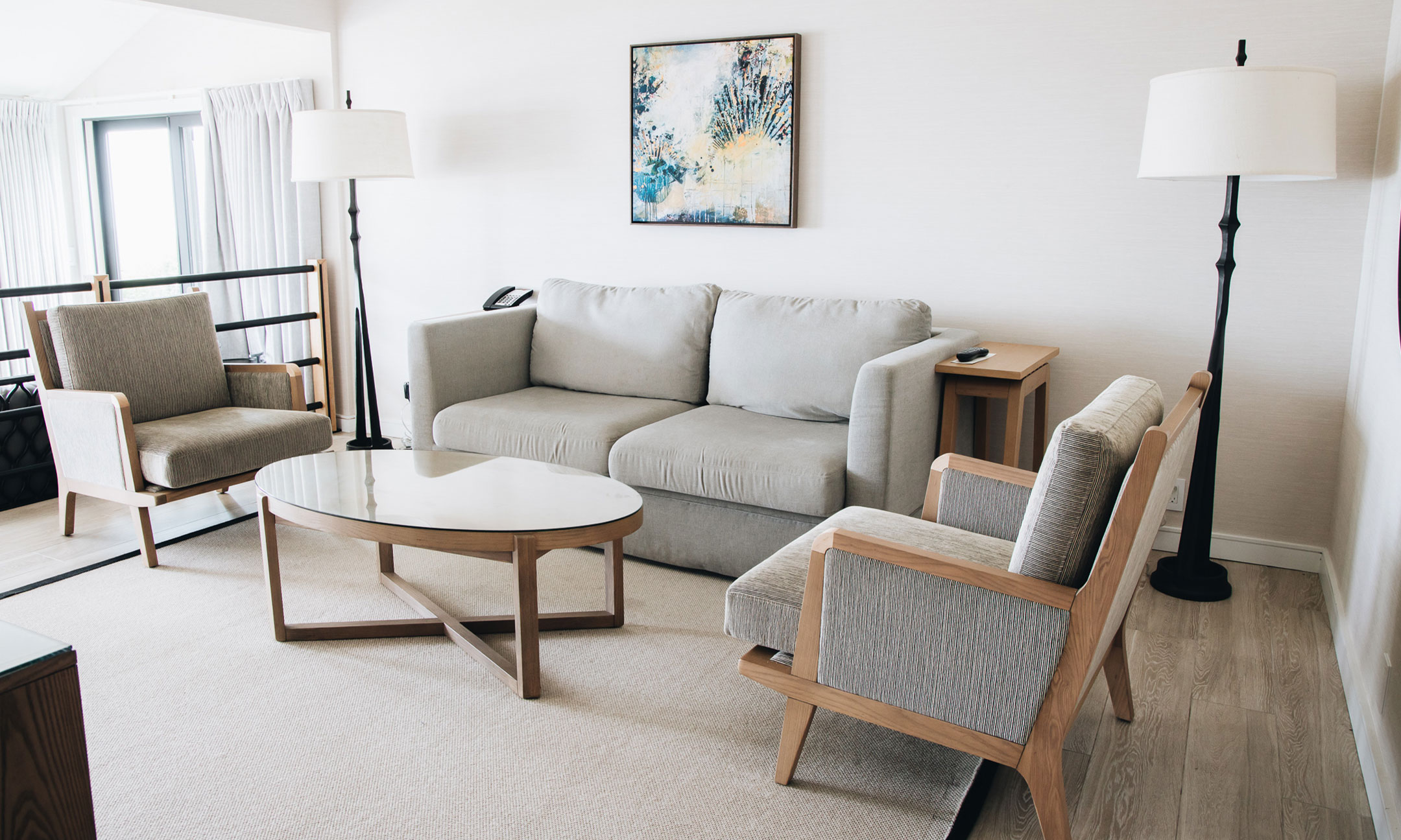 two arm chairs and sofa with a coffee table