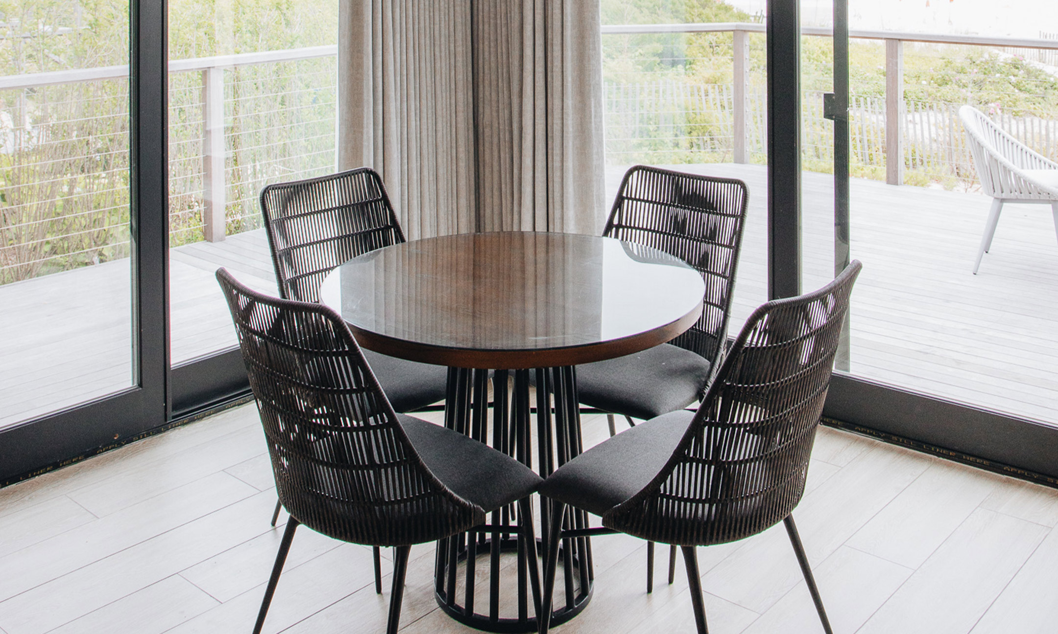 4 chairs around a dining table