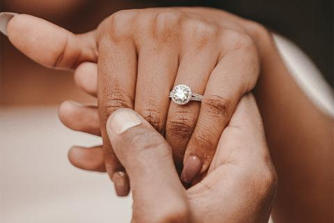 hands with engagement ring